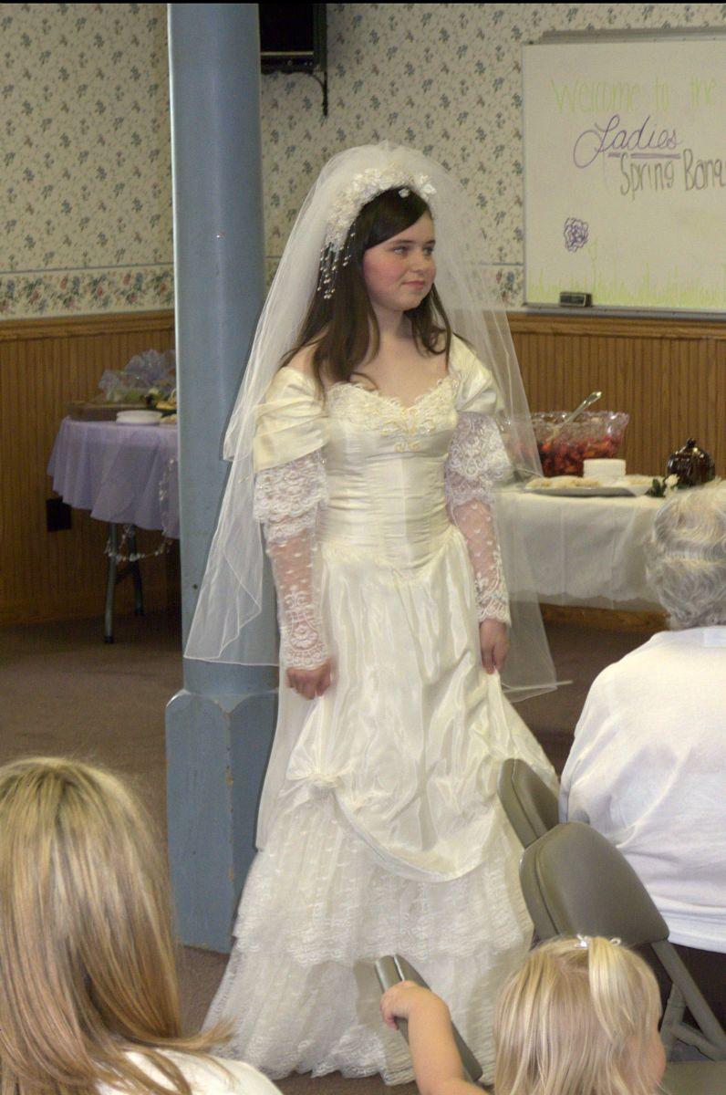 Lydia in Dawn's wedding dress.jpg