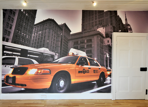 We recently installed a feature wall at our HQ with a New York Theme!  The image, shot by designer/photographer Rob Edwards on a recent trip to the USA was printed to a Neschen Solvoprint sand finish wallpaper material and fitted on one of the large walls in our Usk office.  The result is stunning and has created a fantastic feature for the room.  If you'd like see the results for yourself, you're welcome to visit our offices, in which we have another feature wall like this. Just  get in touch with us  to make an appointment.