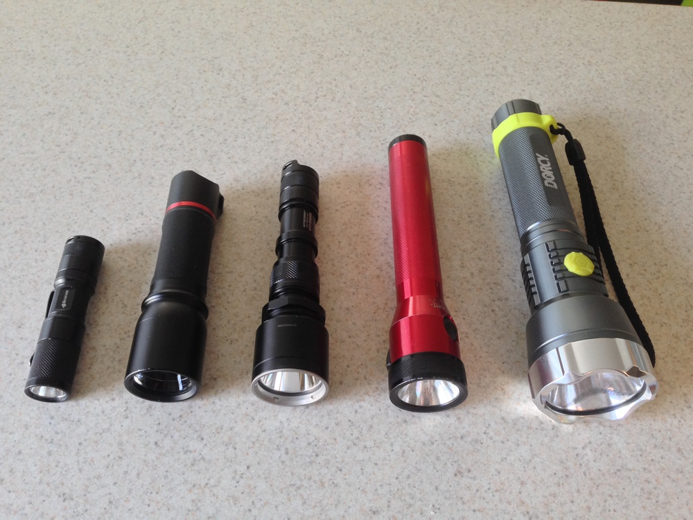 Left to right: 4Sevens Quark AA tactical, Coast HP7, Nite Core MH25 Night Blade, Streamlight Stinger, Dorcy Metal Gear XL-M