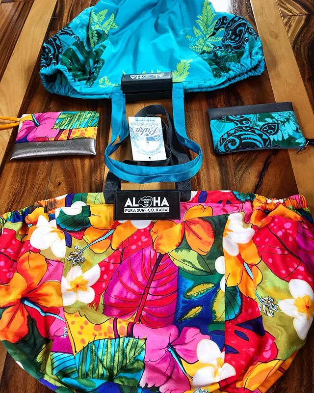 Take a step on the 🌺 bright side of life. Back in stock #holoholobags & matching #pulima clutches.  Buy the Holoholo bag + Pulima and get $5.00 off the set · Quality made in small batches here on Kauai. Holo Holo bags are the perfect carry all bags. It even makes shopping easier with handles that clip directly onto the cart. The Pulima wrisets are used most favorably as a easy to carry wallet. It's equipped with a comfy elastic for your wrist on the outside and credit card organizer on the inside. It even makes a great jewelry travel bag. #kauai #shopkauai #madeinkauai #supportsmallbusiness