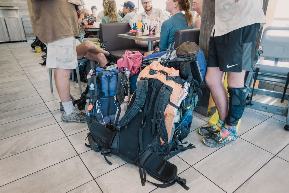 "Piles of backpacks. Or the international ""we're hikers"" signal."