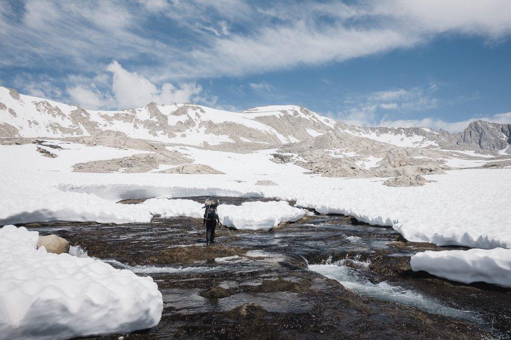 Fyre crossing a snow melt.