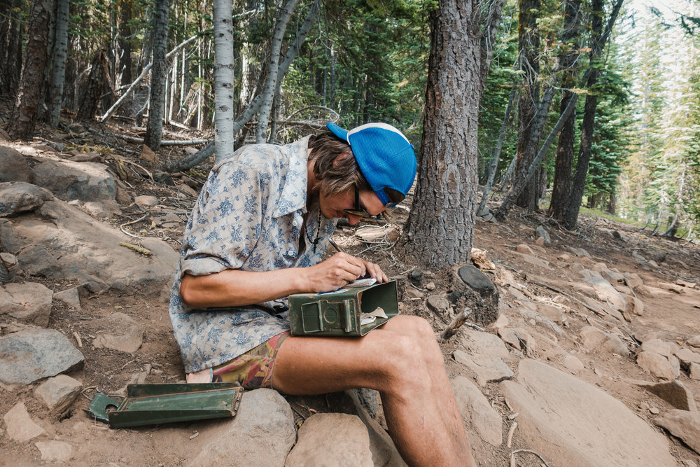 Sam writing to the trail register.