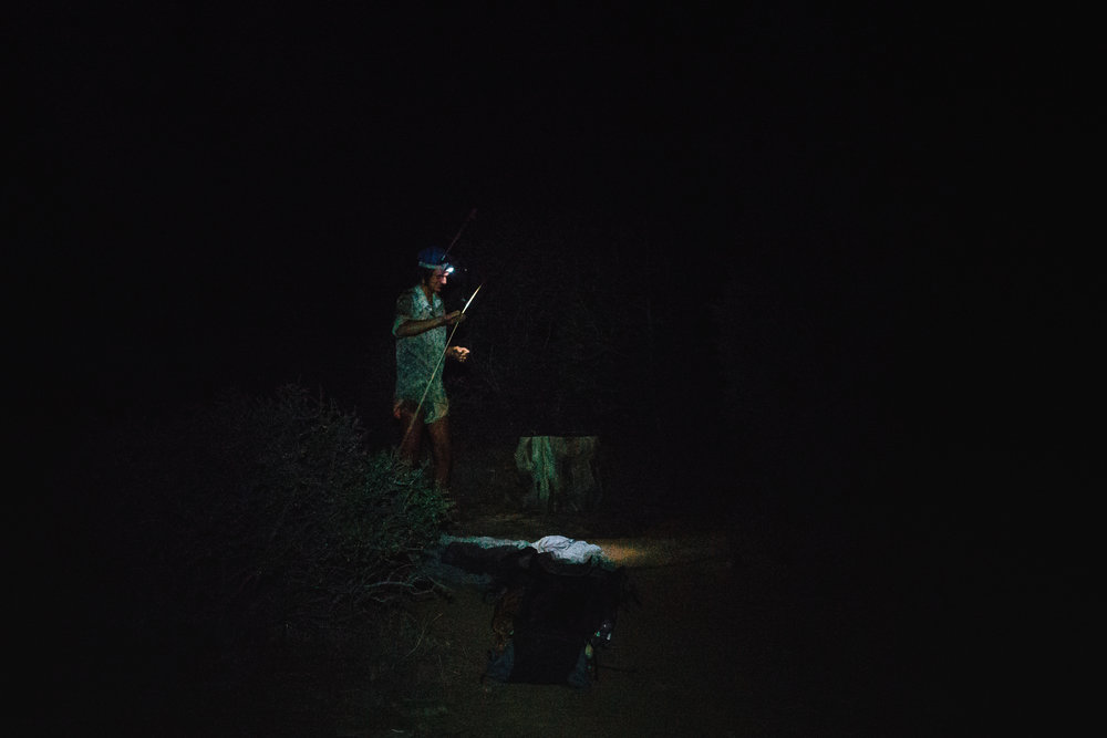Sam pitching his shelter in the dark at Cache 22.
