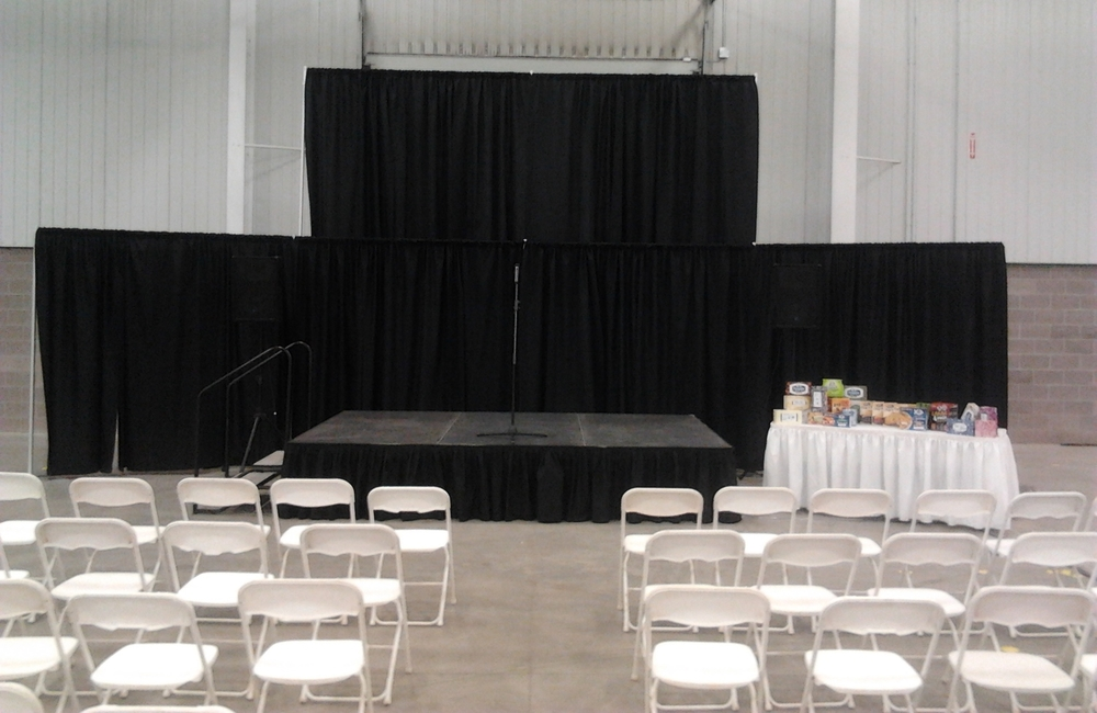 "Pipe And Drape   Black Drape  $2.75 sq/ft  White Plastic Folding  $ 2.25   Stage Decks - 4'x8' per section  24"" height$ 60.00"