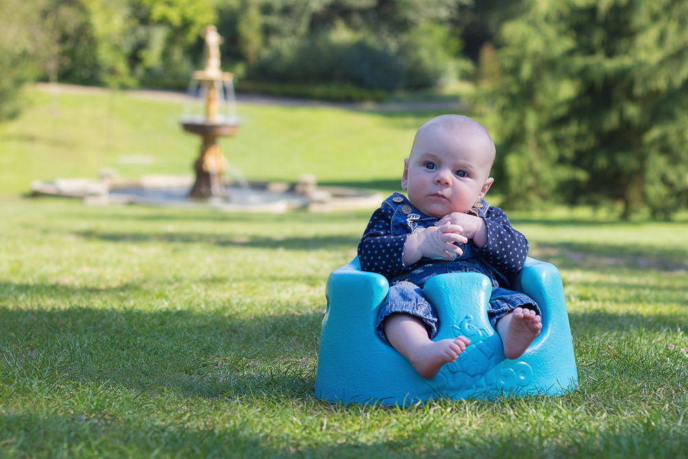 3 month old boy sitting in his blue bugaboo in Tunbridge Wells park