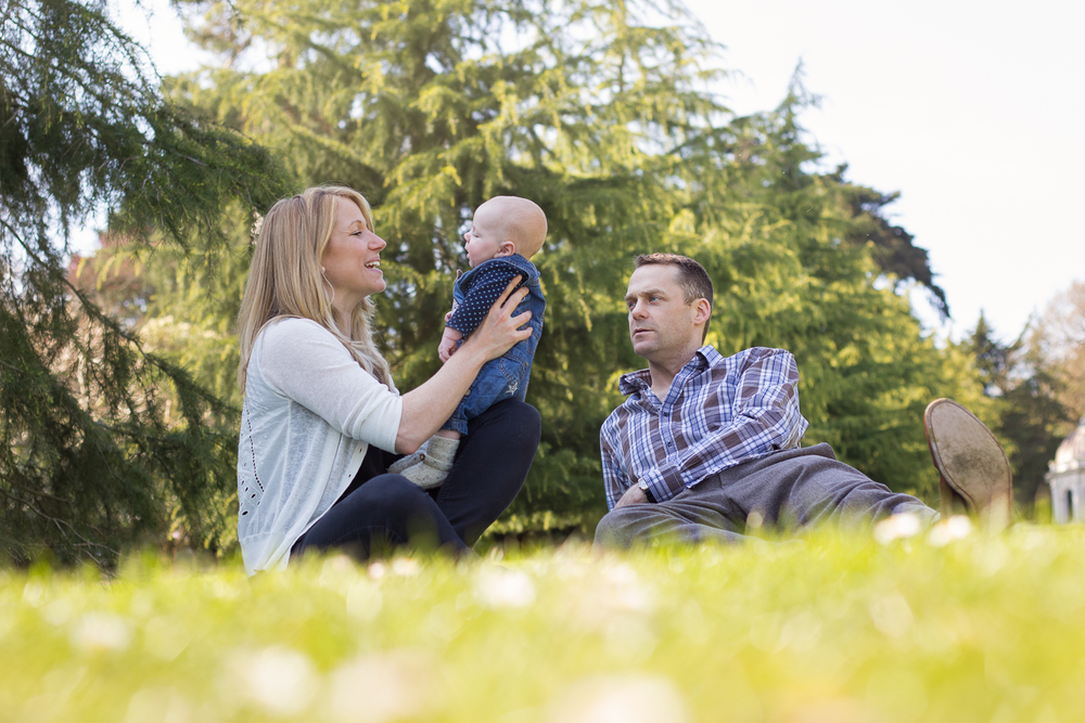 Dunorlan Park family photo session with Mum, Dad and baby boy smiling at one another