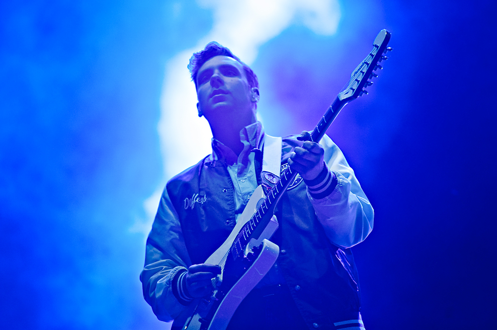 Professional photograph of the guitarist from Two Door Cinema club at Bestival festival