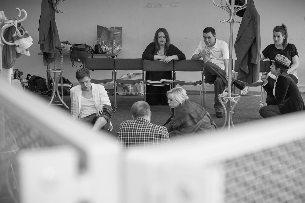 Ripped Script theatre company rehearsing at Salisbury Playhouse - a group shot of the company sitting talking to eachother