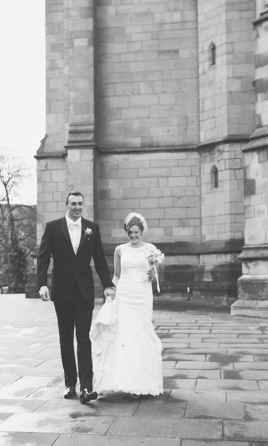 The bride and groom leaving the church - a beautiful black and white image
