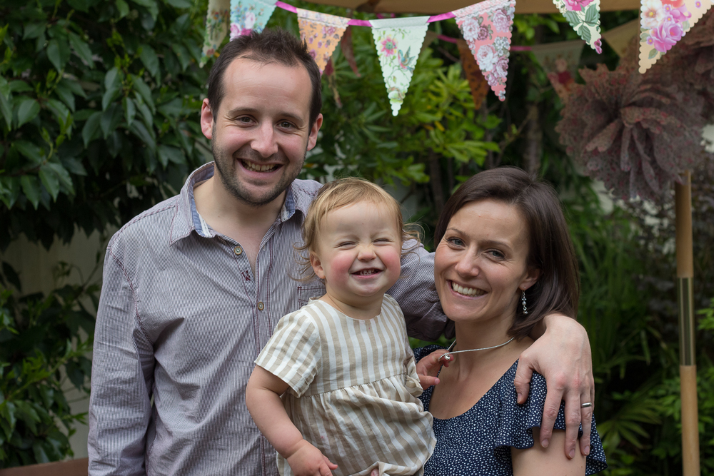 A professional family photograph of a small Tunrbidge Wells family after the birthday party of their two year old daughter