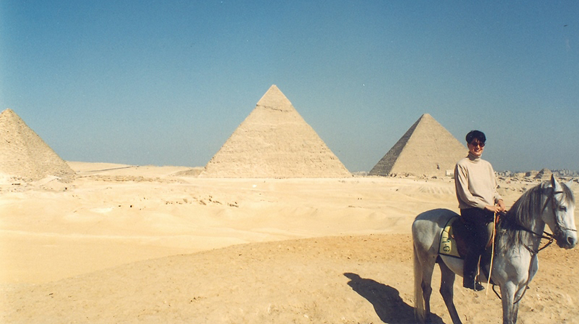 When I lived in Cairo I liked riding horseback near the pyramids.