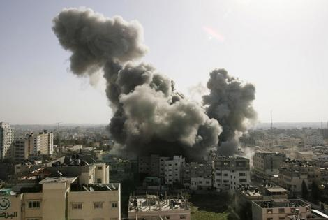 Smoke rises over the main Hamas security complex following an Israel air strike in Gaza.