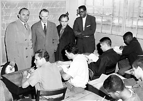 P.S. 616 in September, 1959. DOC Commissioner Anna M. Koss, former Commissioner Austin MacCormick  (second left) a leader in promoting inmate education.  The original school with eleven classes was set up in a warehouse.