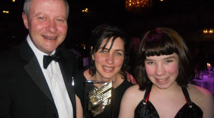 Rosie (right) picks up her award with BBC Children's boss Joe Godwin (left) and programme producer Victoria Bell