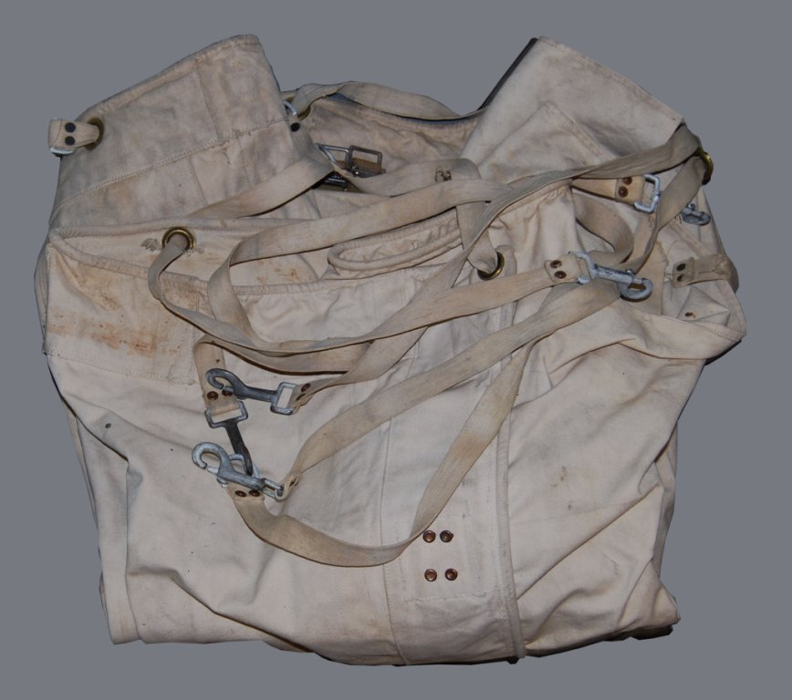 Straight jacket, mid-20th century Restraint of patients took many forms, from Benjamin Rush's tranquilizing chair of the 1790s to isolation cells, chains, and medication. This stiff canvas bed restraint has webbing ties and weighs about twenty pounds.
