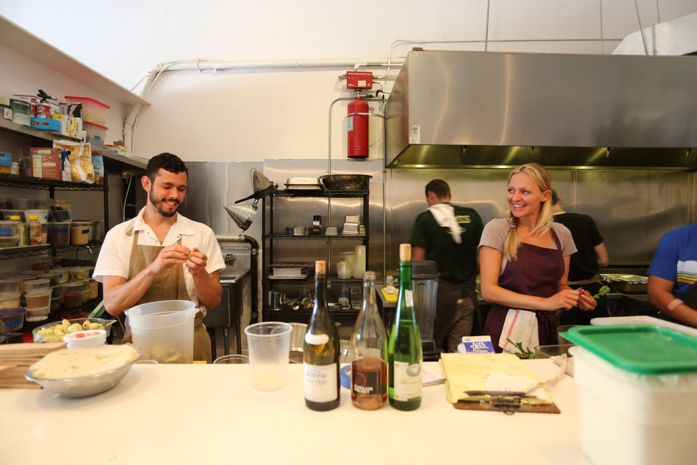Chef Ari Taymor prepping with farmer and cook Courtney Guerra at Alma.