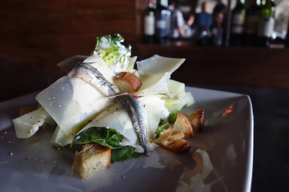 Caesar salad with little gem lettuce, white anchovies and piave. (Photo by Nicole Reed)
