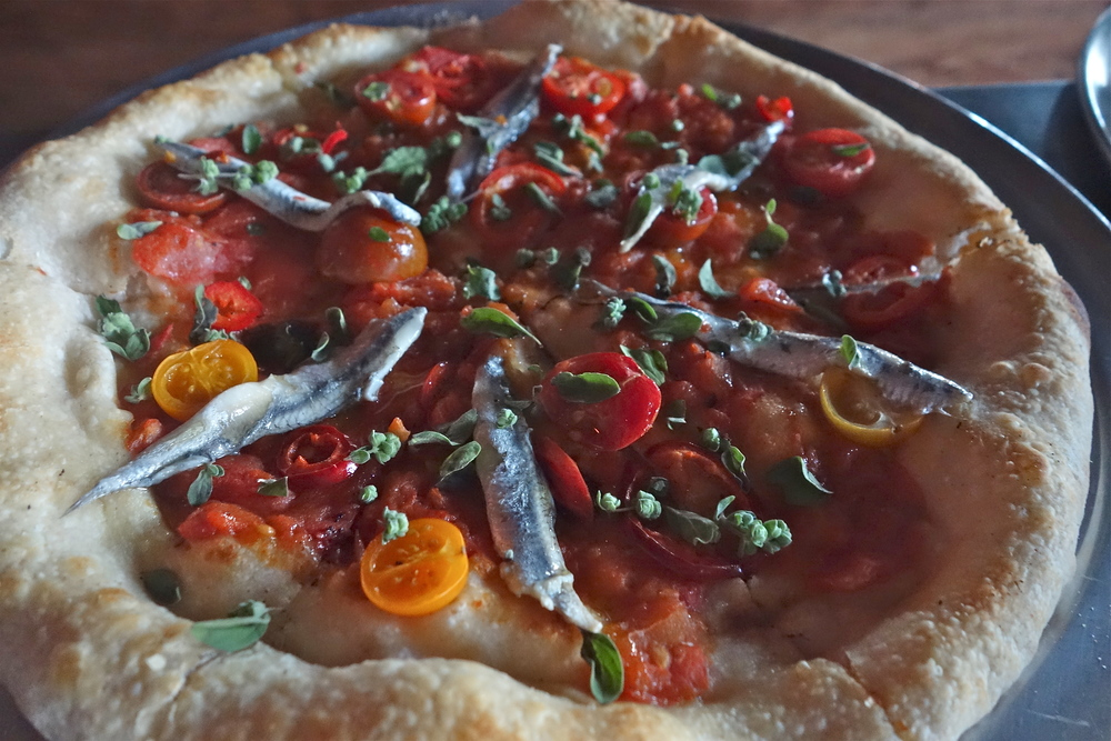 The Gondola has roma tomatoes, cherry tomatoes, Fresno chilies, white anchovies and Sicilian oregano. (Photo by Nicole Reed)