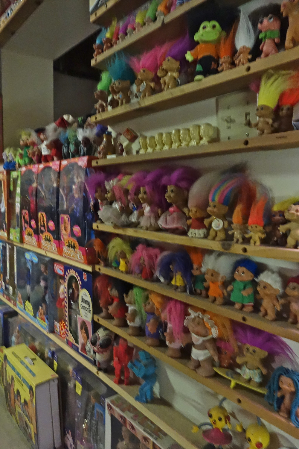 Trolls are one of many colorful collections on display in Rose's loft.