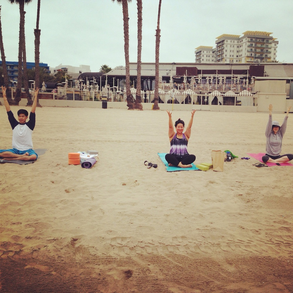 teaching yoga at mothers beach.jpg