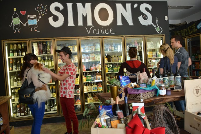 Happy shoppers mingle at the newly-opened  Simon's Provisions  on Rose Ave., a craft beer, wine and snack store that took over the former Rose Market liquor store. ( Photo by Angelina Attwell )