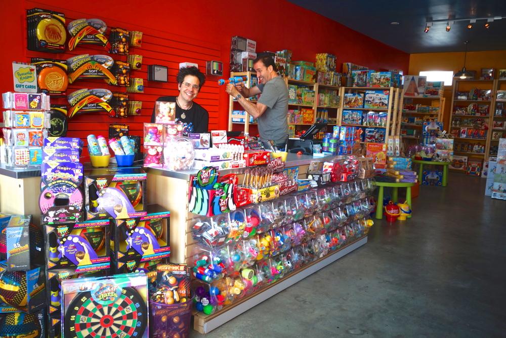 Huzzah! owner Joe Falzarano takes aim at friend and co-worker Jon Hill