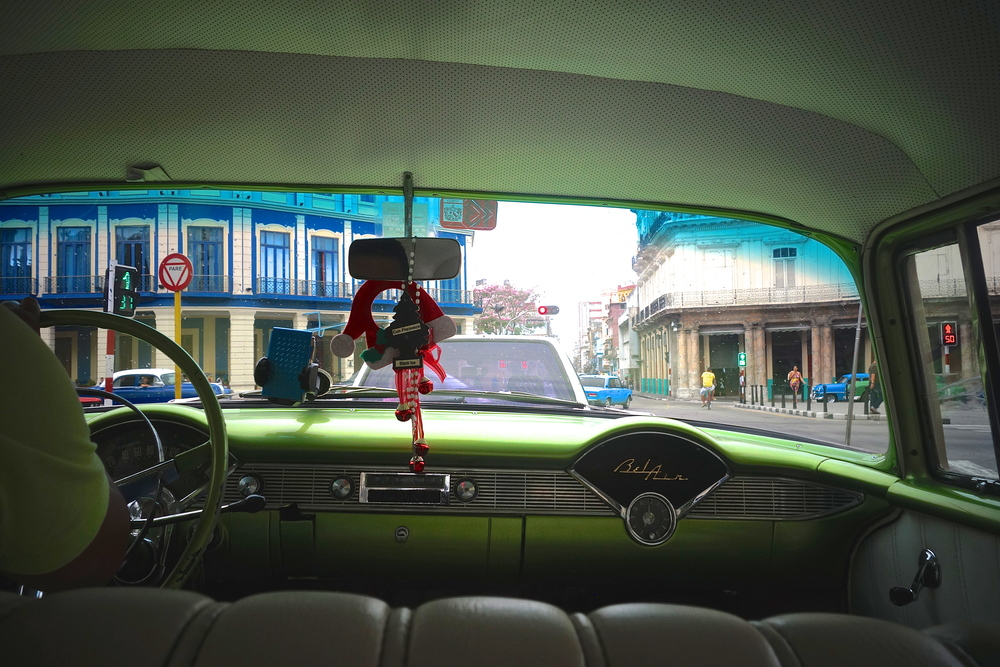 View from the back seat of our lime green Chevy Bel Air, we drove through the neighborhoods of Havana.