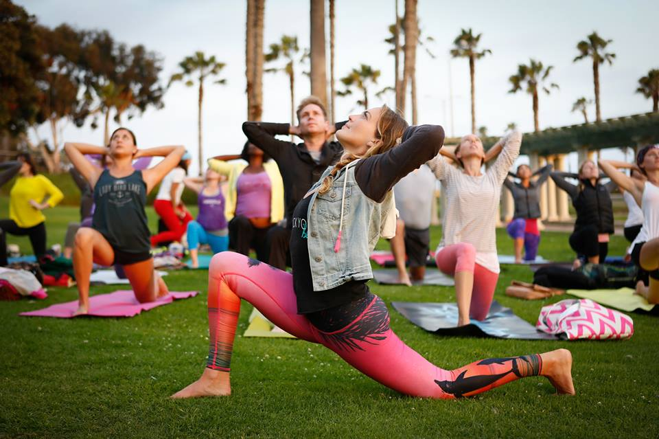 Yoga instructor and life coach Mary Beth LaRue takes one of her Rock Your Bliss workshops outdoors to breathe in the ocean air. (Photo by Patricia Pena)