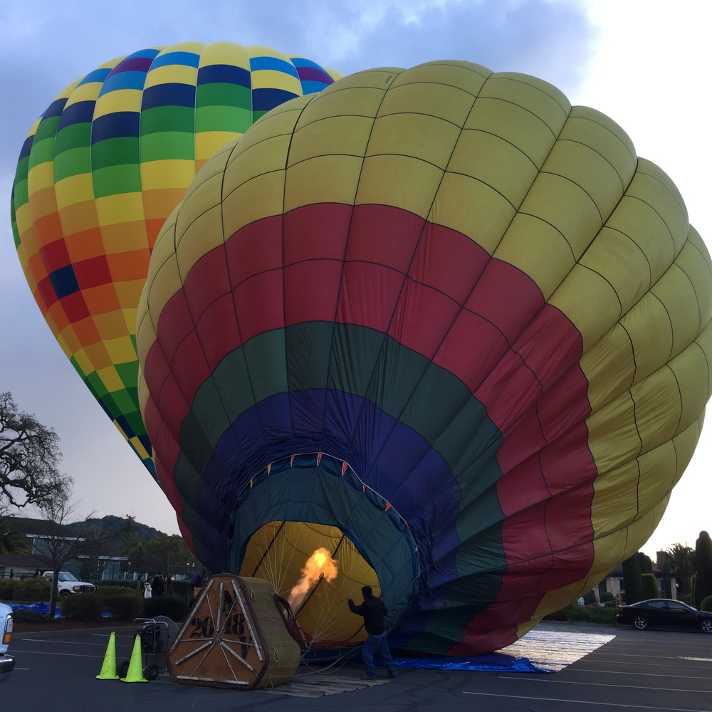 Powering up the balloons at sunrise.