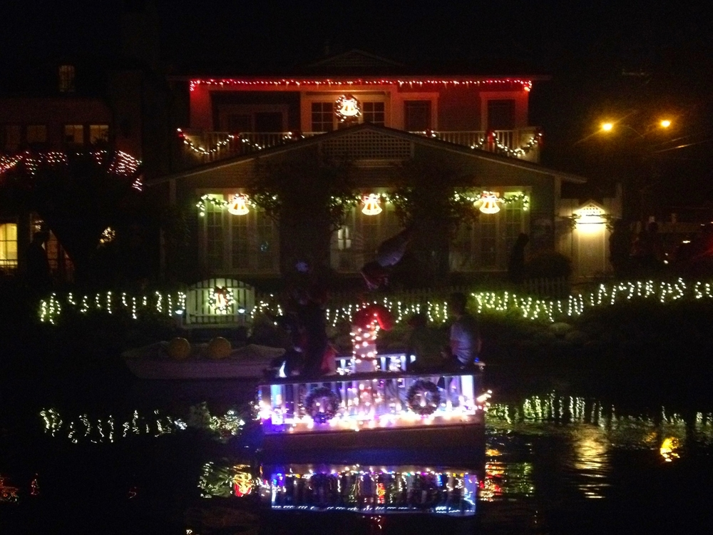 The 34th annual Holiday Boat Parade lights up he Venice Canals on Sunday.