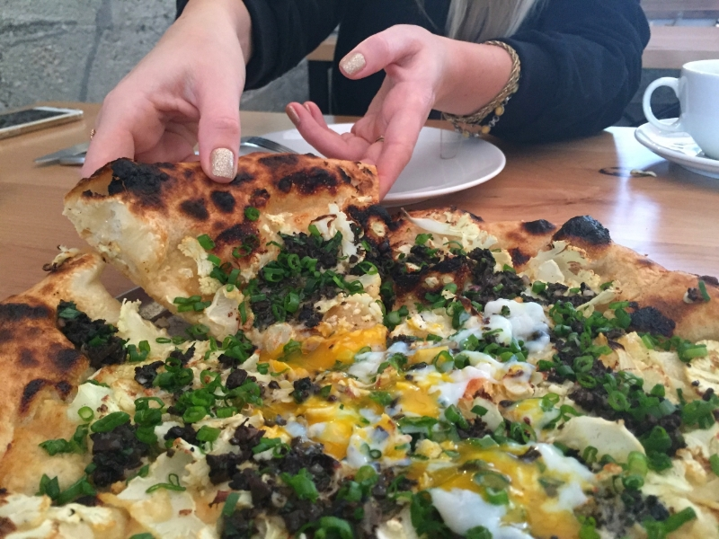 Black & White pizza topped with an egg. ( Photo by Nicole Urso Reed. )