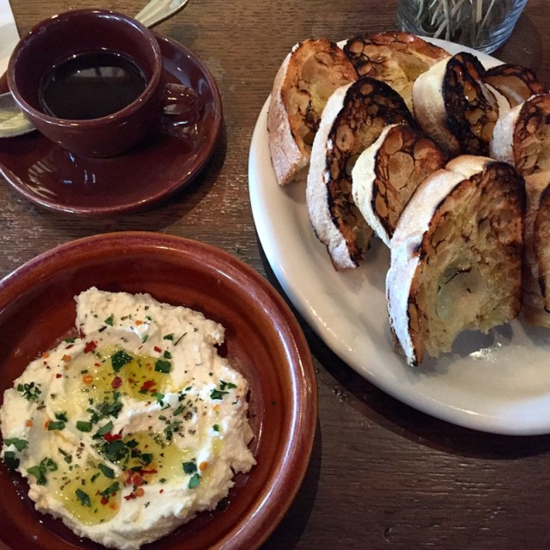 Essential starter: Fresh ricotta and herbs, garlic toasts and a personal pot of espresso. ( Photo by Nicole Urso Reed  @lincolnandrose  .)