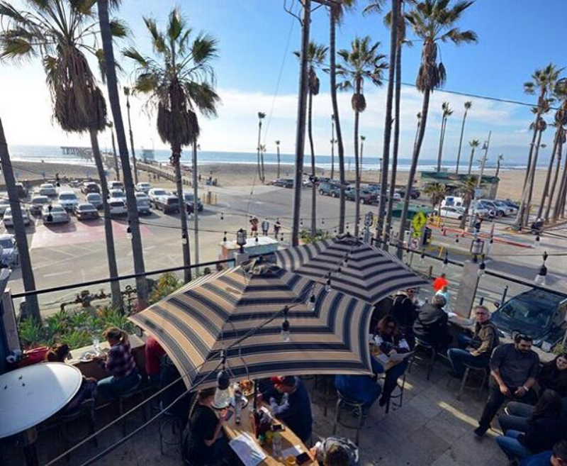 Patio dining at The Whaler with a front row view of the Venice Pier. ( Photo by  @thevenicewhaler  .)