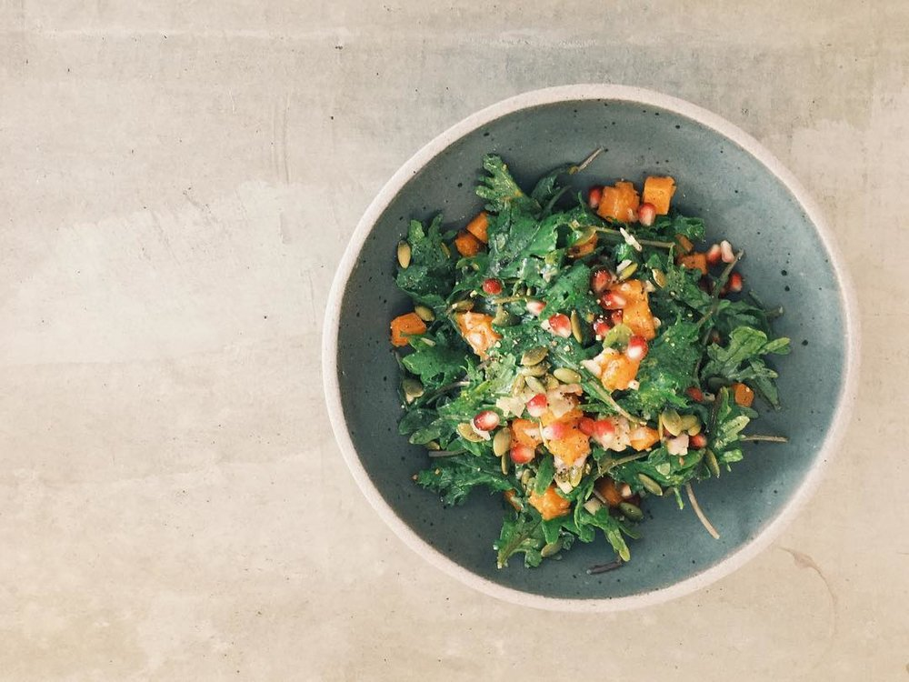 Farytale pumpkin and pomegranate add fall flavor to this red Russian kale salad.
