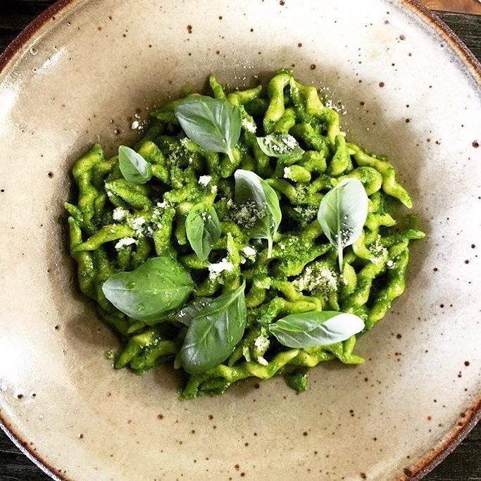 Trofie with a basil pesto and topped with shavings of mild Pecorino di Malga. ( Photo by Janet Zuccarini for Felix Trattoria )