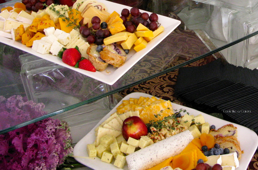 A cheese assortment ready for service at a wedding reception, makes a beautiful make ahead appetizer. Photo by Dinner At Eight Productions.
