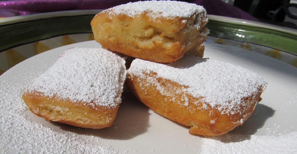 Freshly cooked and powdered beignets. As delicious as they look!