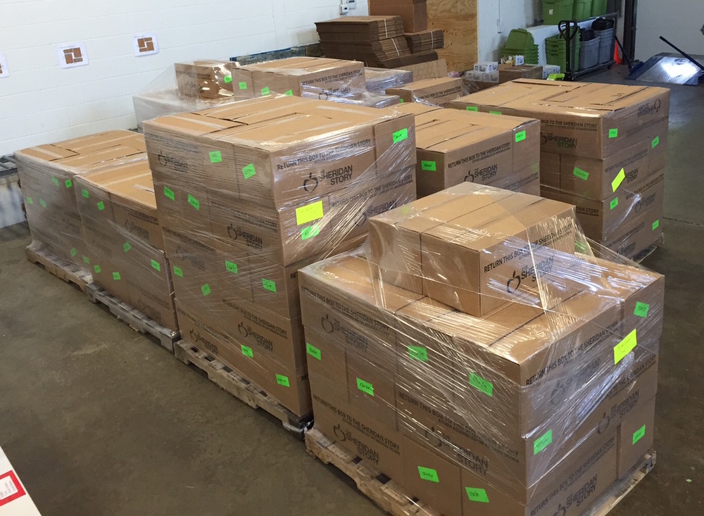 First shipment of 1,690 of The Sheridan Storybags of food for our summer program