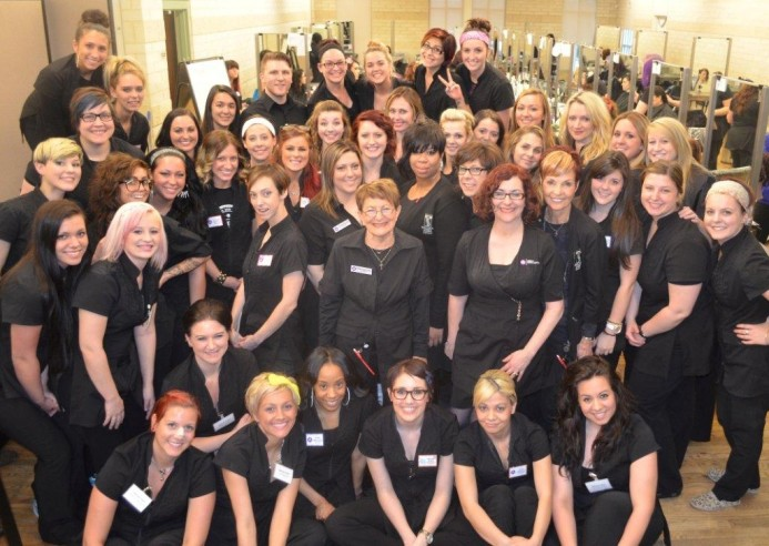 Berni Marcotte, Center, with her team members and students at The Brown Aveda Institute in Mentor, Ohio.