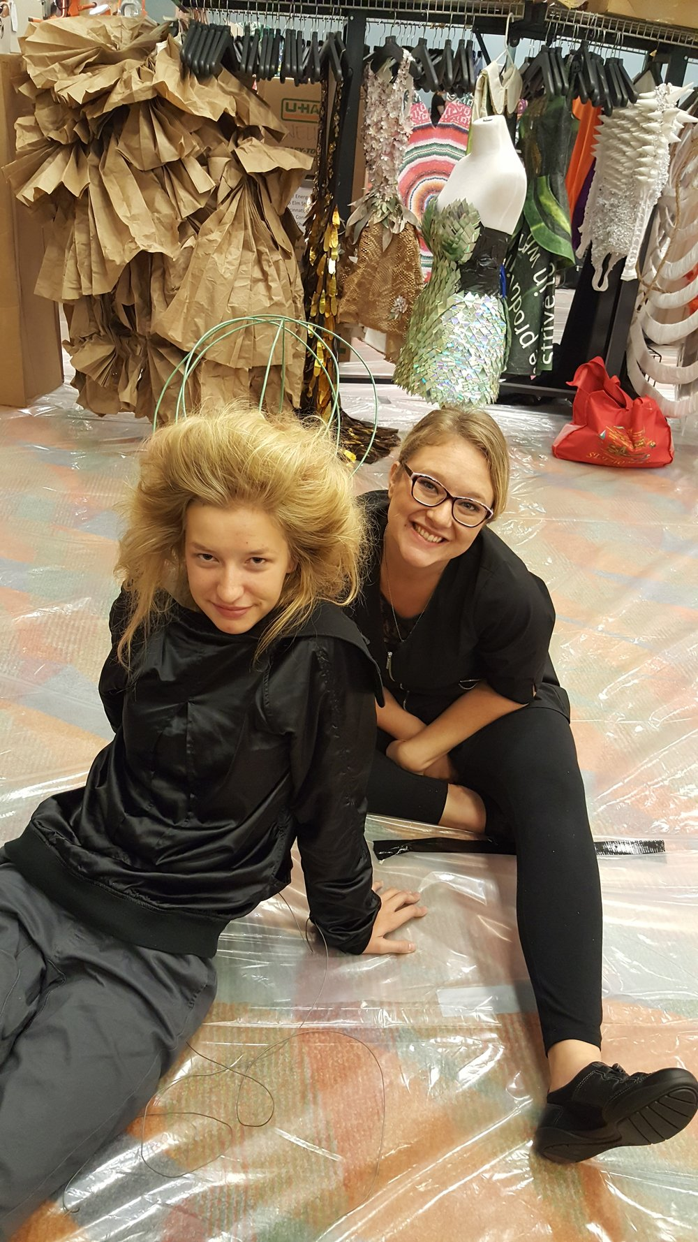 Student Dasha Olecki taking a well-deserved break with her model