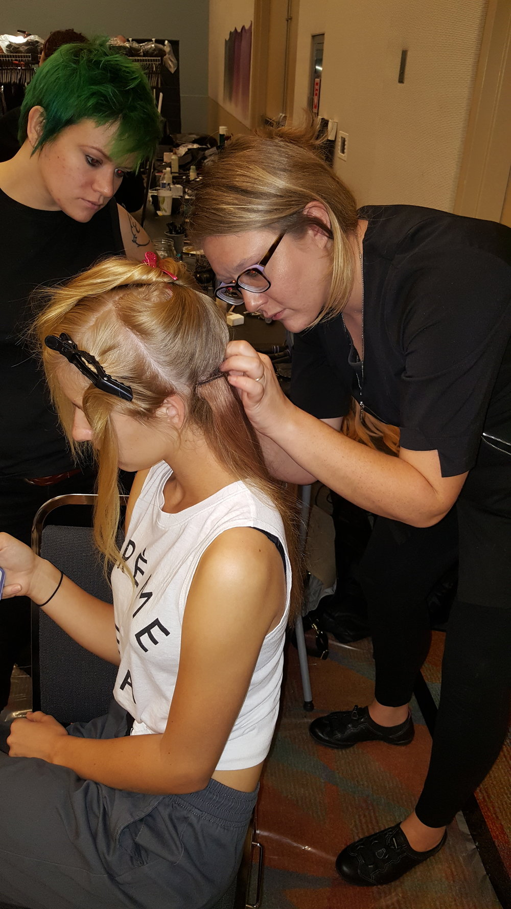 Students Hailey Hughes and Dasha Olecki prepping Models Hair