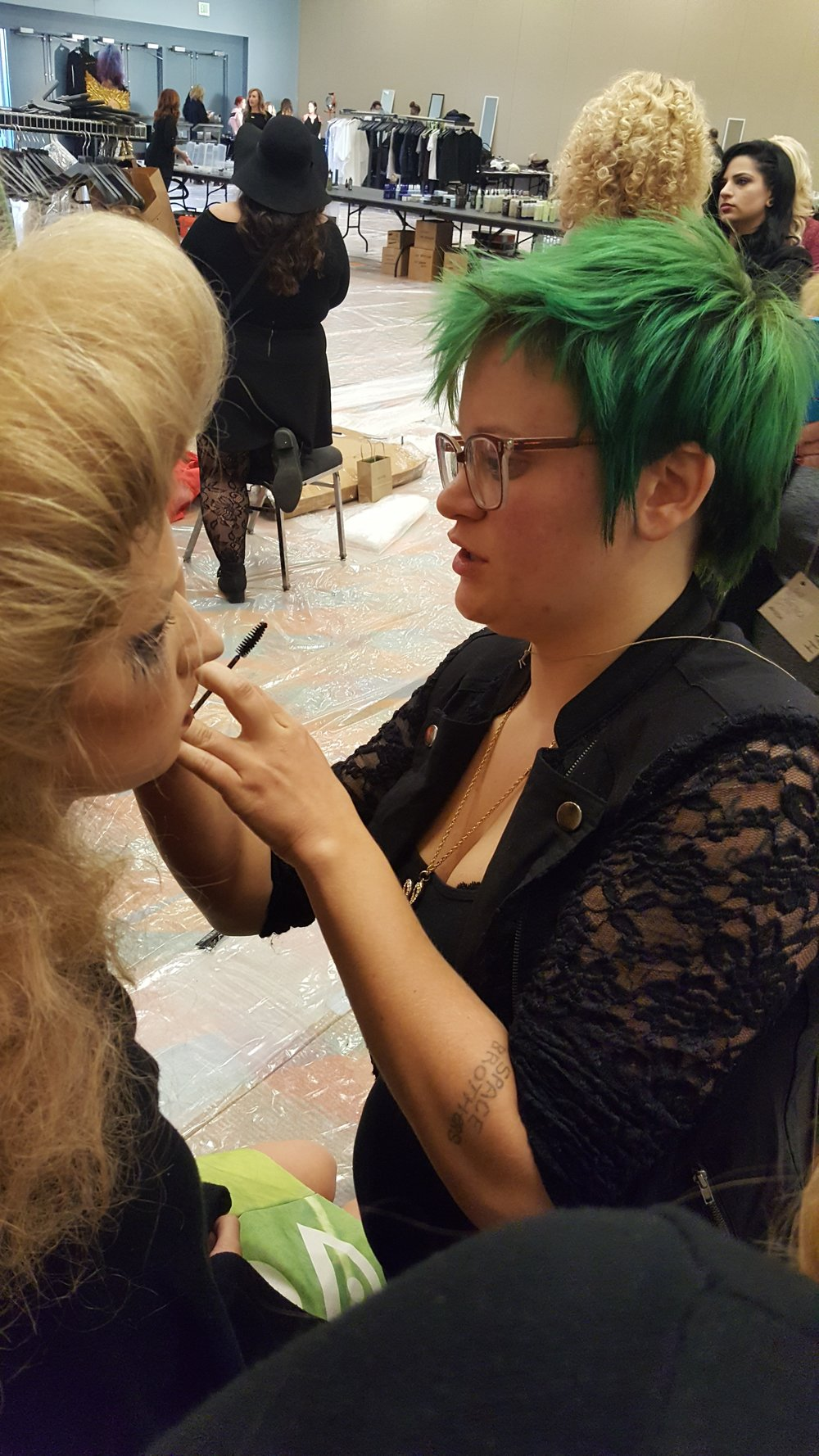 Student Hailey Hughes completing model's make up