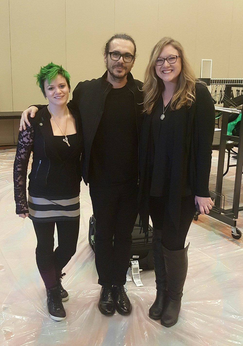 Student Hailey Hughes, Aveda Global Artistic Director of Haircutting Ricardo Dinis, and student dasha Olecki