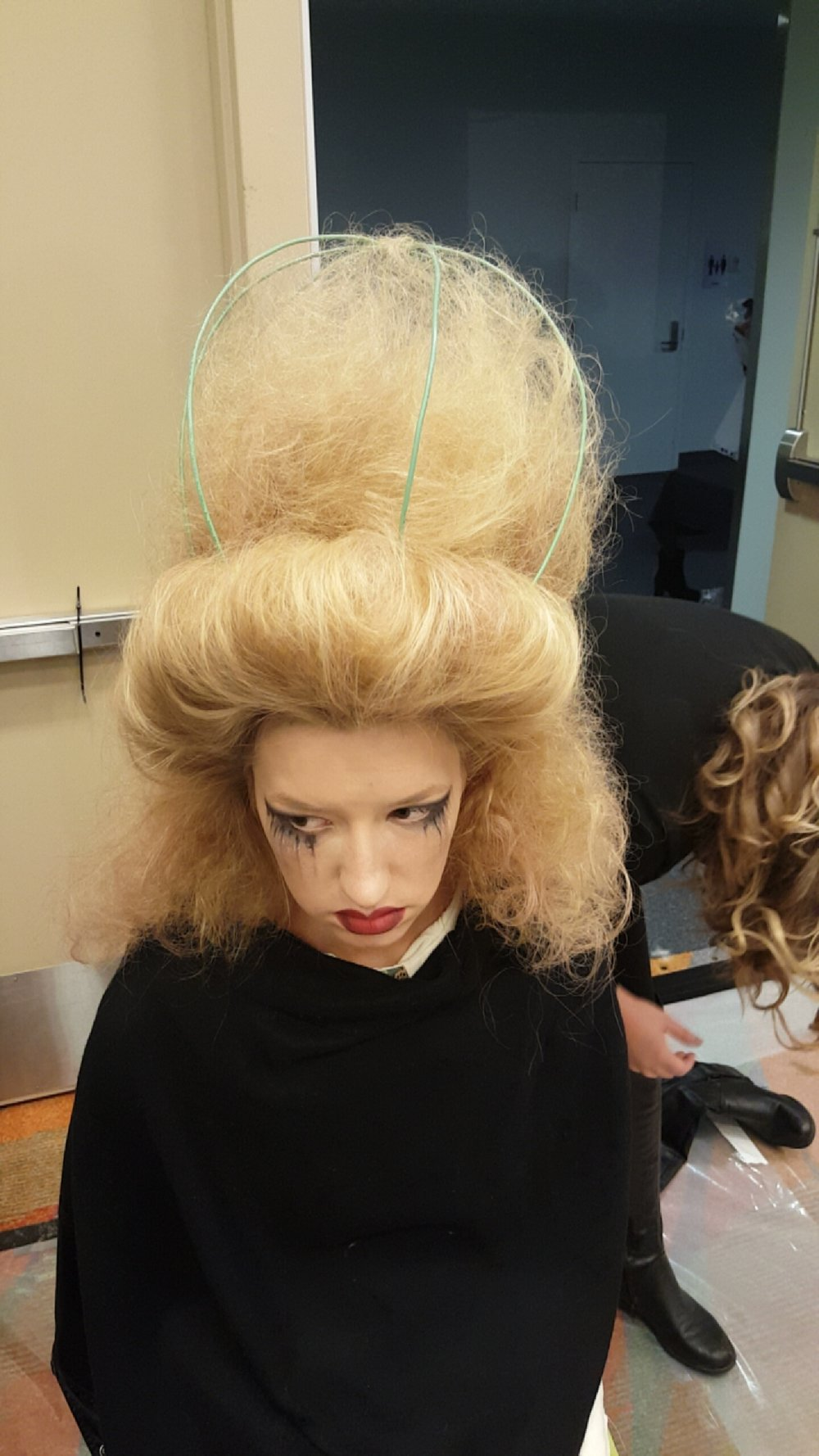Model pre wardrobe with completed hair and make up