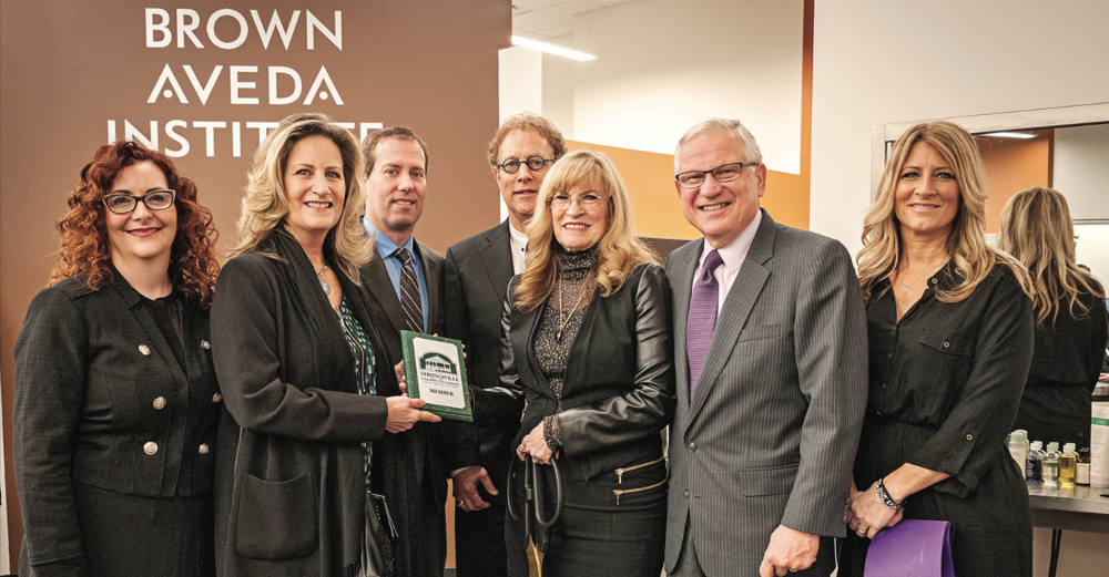 The Brown Aveda Institute at SouthPark Center held a ribbon cutting on March 21 marking the opening of its new location. Pictured are (left to right) Holly Brown, Strongsville Chamber of Commerce Executive Director Amy Ferree, SouthPark Mall General Manager Kurt Reddick, Ed Brown, Nancy Brown, Strongsville Mayor Thomas Perciak and Susie Partin.