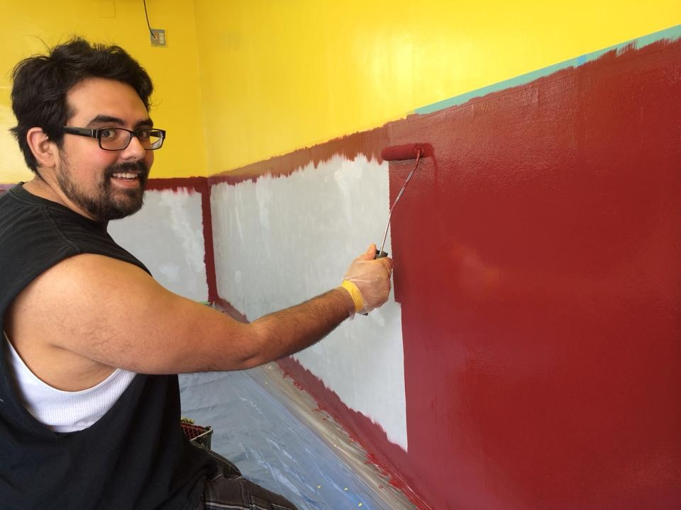 Eder Diaz painting the new church building fellowship room and English classroom.
