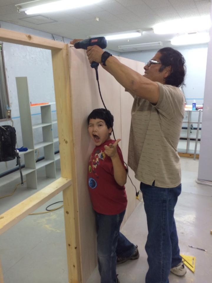 Pastor Tom and Asa Ruiz building a divider for the kitchen in the new building.