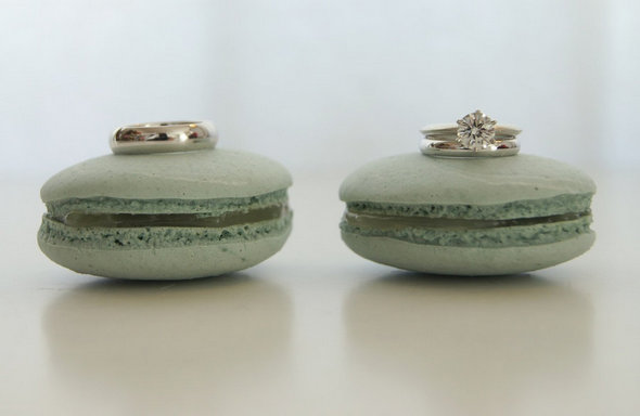 diamond-engagement-ring-grooms-wedding-band-shot-on-green-macaroons.original