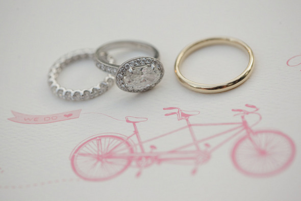 vintage-engagement-ring-with-wedding-bands-atop-wedding-invitation.original